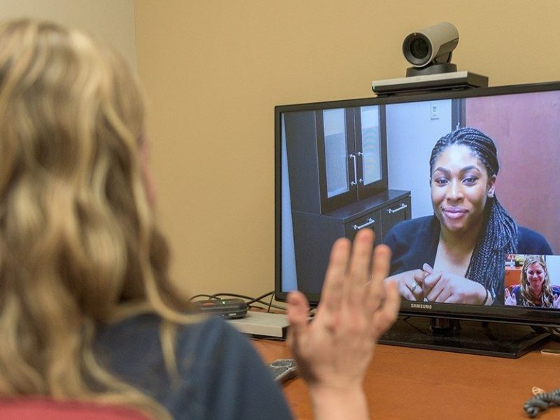 Counselor works with client via telehealth