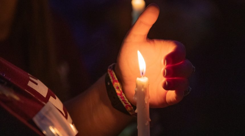 holding candle 2019 'Not Another Aggie' Suicide Awareness Walk