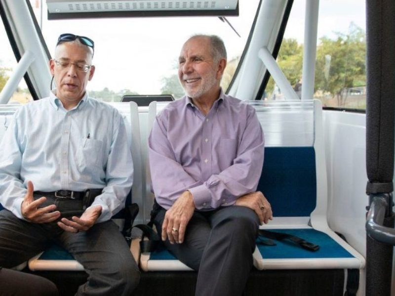 TTI Senior Research Scientist Bob Brydia explains the technology behind the autonomous shuttle to Texas A&M President Michael Young as they ride around Texas A&M's campus Sept. 25.