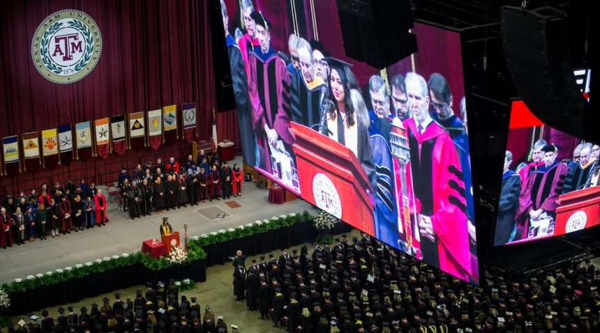 the jumbotron in reed arena showing a graduation speech above the graduates