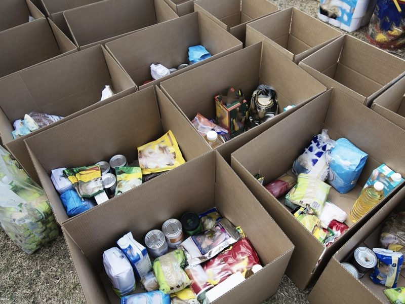 a photo of cardboard boxes filled with food donations