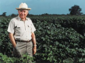 perry adkisson standing in a field