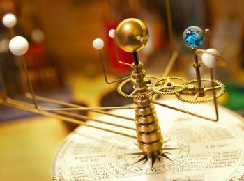 Planets orbit the sun on an Orrery.