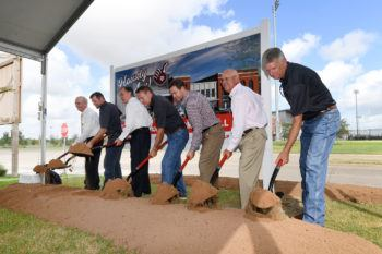 seven officials turning dirt at groundbreaking