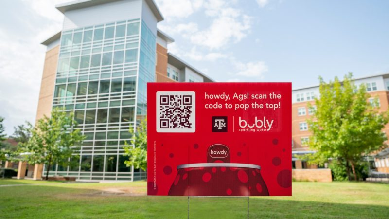 a Howdy Bubly sign with QR code