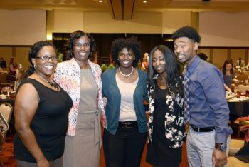 Butler-Purry poses with graduate students at a university event