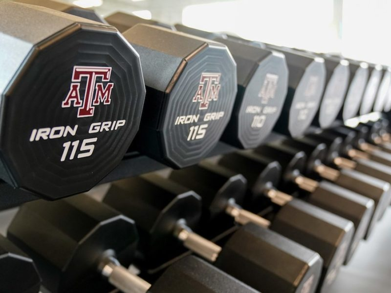 close up shot of a row of weights with the A&M logo