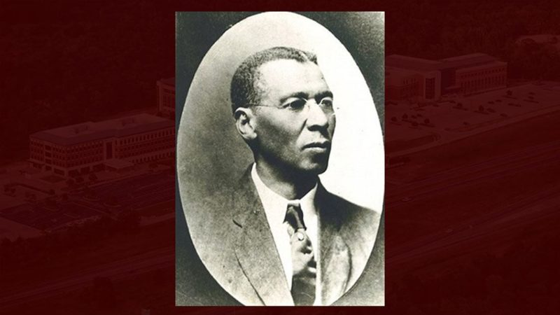 black and white portrait of cooper against maroon background
