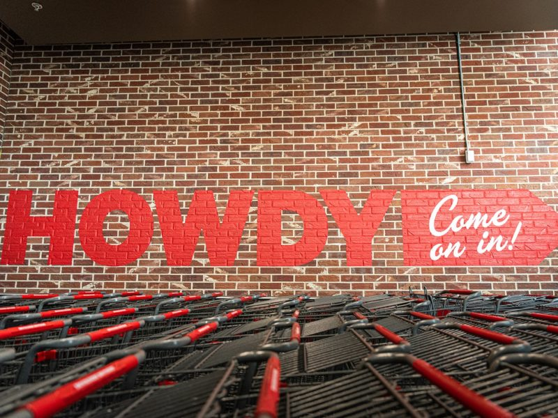 a photo of the word Howdy on a wall outside the store