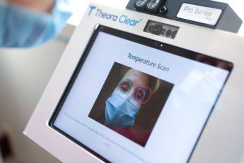 image of a woman's face in kiosk screen