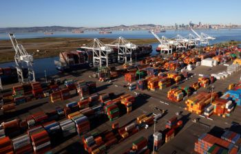 Shipping containers sit on a dock at the Port of Oakland on March 26, 2021 in Oakland, California.