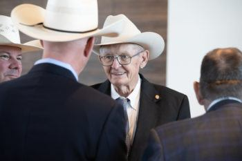photo of men in cowboy hats talking at grand opening ceremony