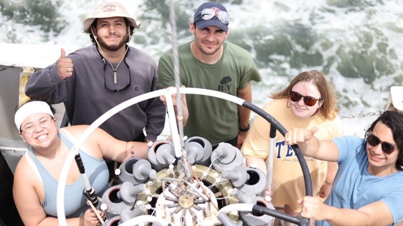 students on board gathered around ctd rosette