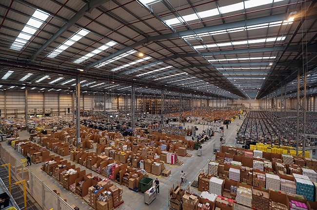 Employees select and dispatch items in the huge Amazon 'fulfilment centre' warehouse on November 28, 2013. (Photo by Oli Scarff/Getty Images)