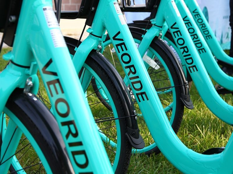 Close-up of teal VeoRide bikes in a row